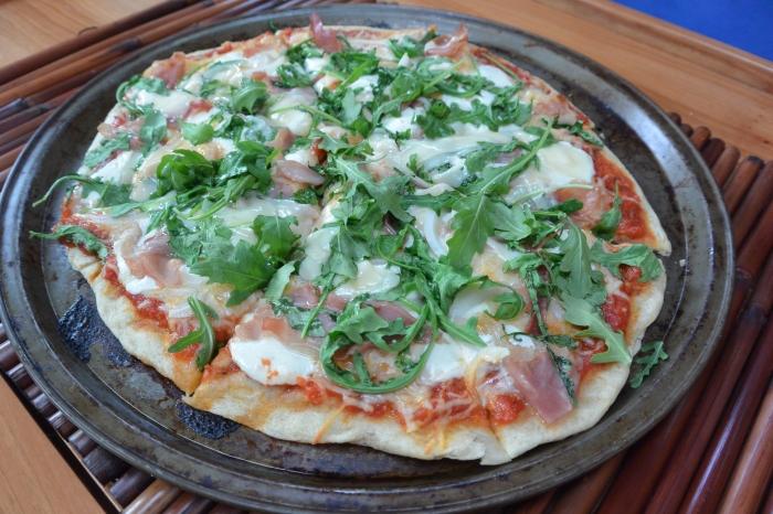 prosciutto pizza sliced